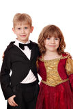 Boy in tuxedo and little girl Royalty Free Stock Photo