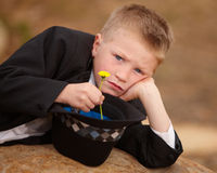 Boy in tuxedo sad with yellow flower Stock Photos