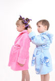 The boy twists to the girl hair curlers Stock Photo