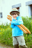 The boy with two baguettes Royalty Free Stock Image