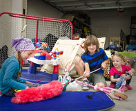 Brother and Sisters Cleaning the Garage Royalty Free Stock Image