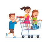 Boy and two girls playing together. Riding supermarket shopping cart. Flat style vector illustration  on white background Stock Photos