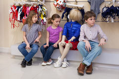 The boy and two girls sitting together with mannequins stock images