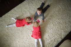 Boy with two girls twins Stock Photography