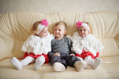 Boy with two girls twins Stock Image