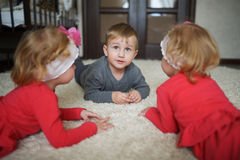 Boy with two girls twins Stock Photos