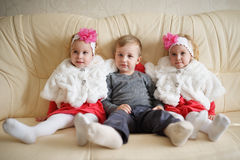 Boy with two girls twins Royalty Free Stock Photo