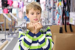 Boy two hands holds metal dumbbell Stock Image