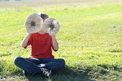 Boy with two parasol mushrooms Royalty Free Stock Photo