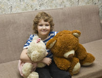 Boy with two toy bears Stock Image