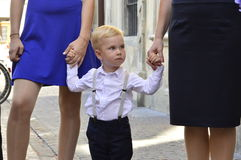 Boy between two women Royalty Free Stock Images