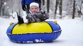 Boy of two years rolling on tubing in the park in winter. Boy of two years rolling on tubing in the park in winter stock video