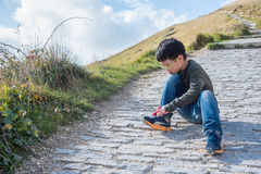 Boy tying his shoelace by himself Royalty Free Stock Photo