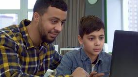 Boy types on keyboard stock video