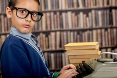 Boy with the typewriter. Retro style portrait Stock Photo