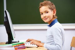 Boy typing Royalty Free Stock Image