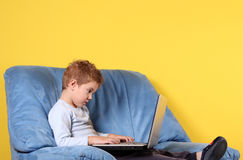 Boy typing on laptop Royalty Free Stock Photo