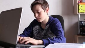 Boy Typing on The Laptop Keyboard stock footage