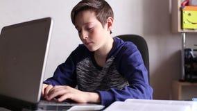 Boy Typing on The Laptop Keyboard. Teen Boy Typing on The Laptop Keyboard stock footage