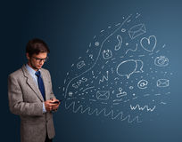 Boy typing on smartphone with various modern technology icons Stock Photo