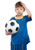Boy in ukrainian national soccer uniform Stock Images