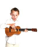 Boy and Ukulele Stock Photo