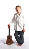 Boy and Ukulele Royalty Free Stock Photo