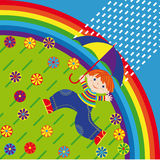 The boy with a umbrella. Runs under a rain on a blossoming meadow on a background of a rainbow Stock Photo