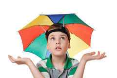Boy with umbrella on head spread hands aside Stock Photo