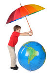 Boy with umbrella and inflatable globe Royalty Free Stock Images