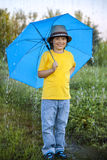 Boy with umbrella outdoors Royalty Free Stock Images
