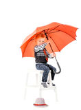 Boy with umbrella studio shot on a white background Royalty Free Stock Image