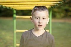 Boy under the metal window ladder stock photo