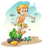 Boy under the sea Royalty Free Stock Images