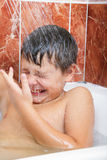 Boy under shower Royalty Free Stock Images