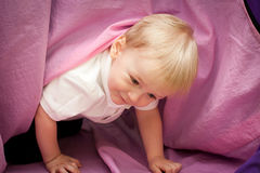 The boy under the table Stock Image