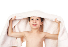 Boy under towel Stock Images