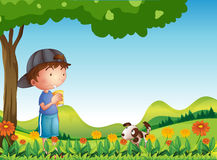 A boy under tree with his pet Stock Image