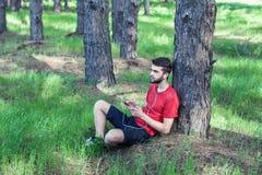 Boy under a tree Stock Image