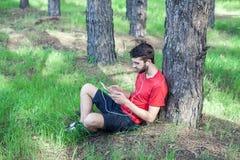 Boy under a tree Stock Photo