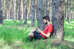 Boy under a tree Royalty Free Stock Photo
