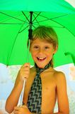 Boy Under  Umbrella Royalty Free Stock Photography
