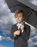 Boy under an umbrella Stock Photo