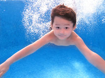 Boy is under the water. The child is in the pool Royalty Free Stock Images