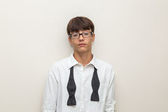 Boy with undone bow tie Stock Images