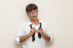 Boy with undone bow tie Stock Image