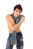 Boy undressed up to a belt. Portrait of a stylish young boy undressed up to a belt, standing against white background Royalty Free Stock Image