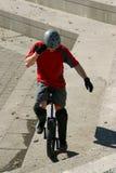 Boy on unicycle stock image