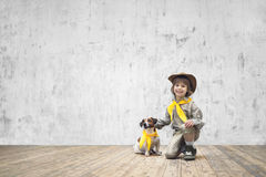 Boy in uniform with dog Stock Photo