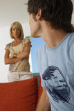 Boy upset, mother in the background. Royalty Free Stock Image
